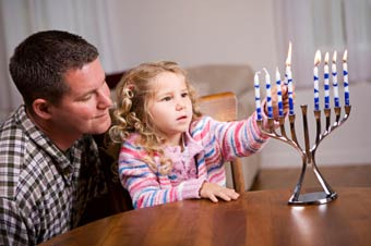 Jewish father and daughter celebrating Chanukah